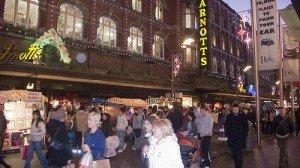 Shoppers under the Christmas lights on Henry Street Dublin