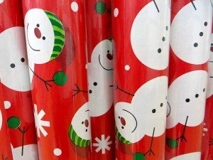 White snowmen on red Christmas wrapping paper