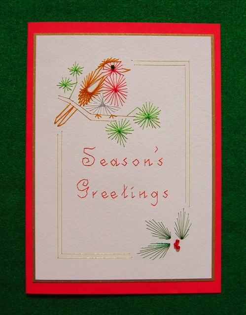An embroidered robin on a hand made Christmas card