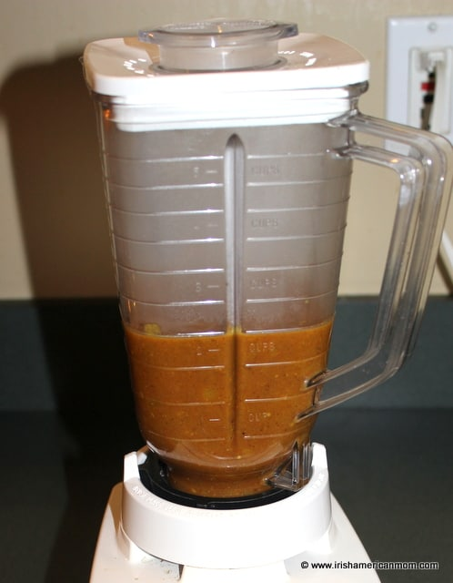 A blender filled with curry sauce to puree