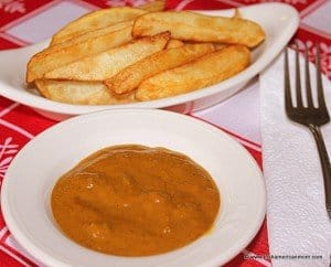 A dish of Irish chips with a side of curry sauce
