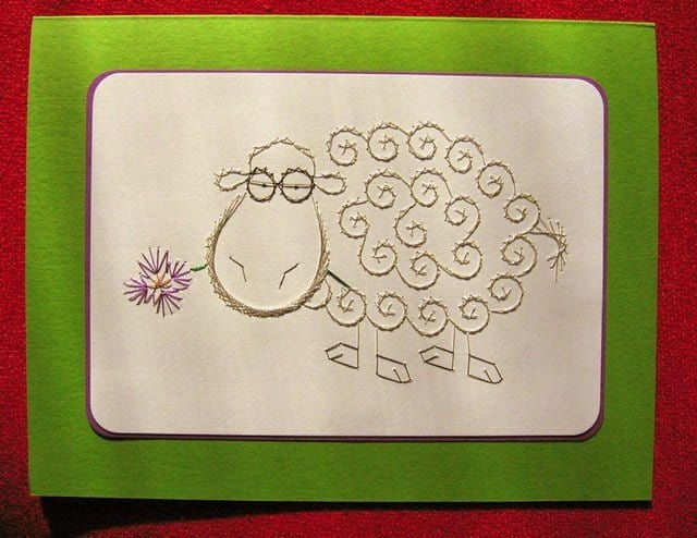 An embroidered sheep on a handmade greeting card