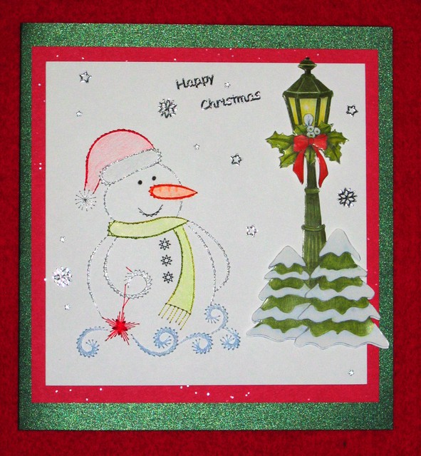 A silver embroidered snowman on a greeting card
