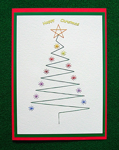 A handmade Christmas card with an embroidered Christmas tree