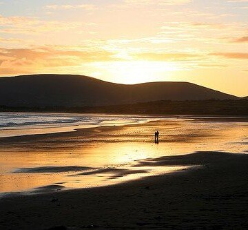 The setting sun over the beach at Waterville in County Kerry on the Ring of Kerry
