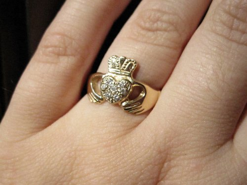 Diamond encrusted Claddagh ring with the heart facing inwards