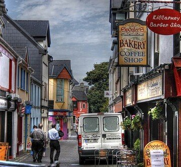 Shop fronts and colorful sign on the streets of Killarney County Kerry Ireland