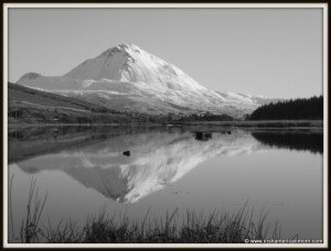A framed image of Mount Errigal with a lake reflection