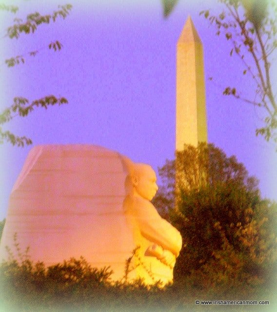 Side view of the Martin Luther King Memorial with the Washington memorial in the background