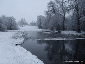 Black and white image of a snowy Doneraile House in County Cork