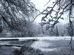 A weir on a river in snow in Doneraile County Cork