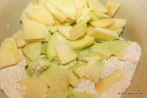 Apples peeled and sliced and added to flour mixture for Irish Apple cake