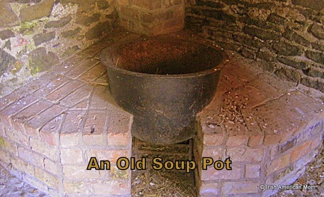 A soup pot over a fire grate