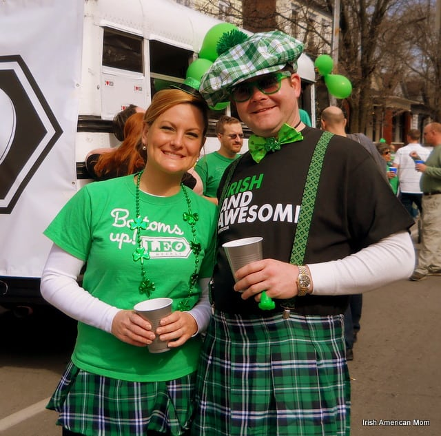 A couple wearing tartan and green clothes posing for the camera