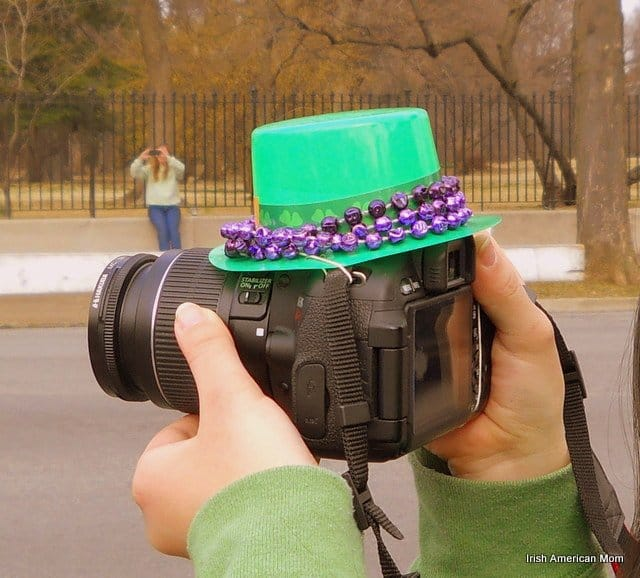 A green hat on top of a camera
