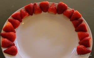 A red arch of strawberries for a fruit rainbow