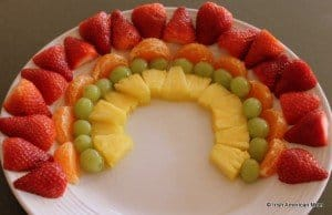 Colorful fruit layers forming a rainbow on a plate