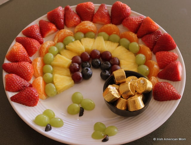 Strawberries, oranges grapes, pineapple and blueberries for a rainbow fruit platter