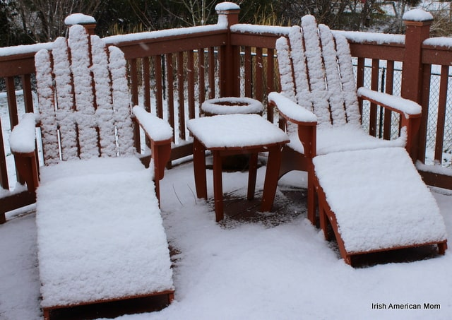 Deck chairs covered in snow