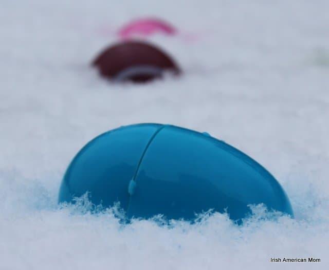 an easter egg nestled in snow