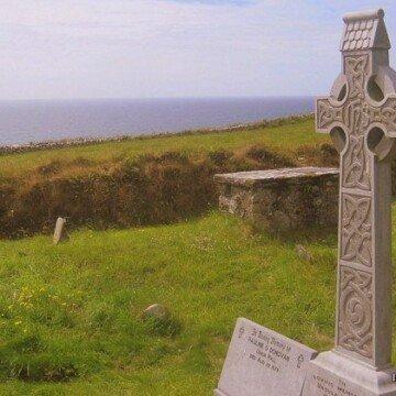 A Celtic Cross in an Irish coastline cemetery