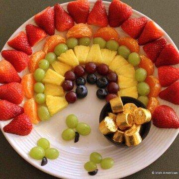 Fresh fruit on a platter shaped like a rainbow