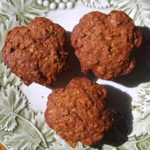 Three brown muffins on a plate