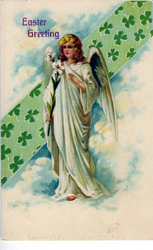 An angel holding a lily with a shamrock border behind