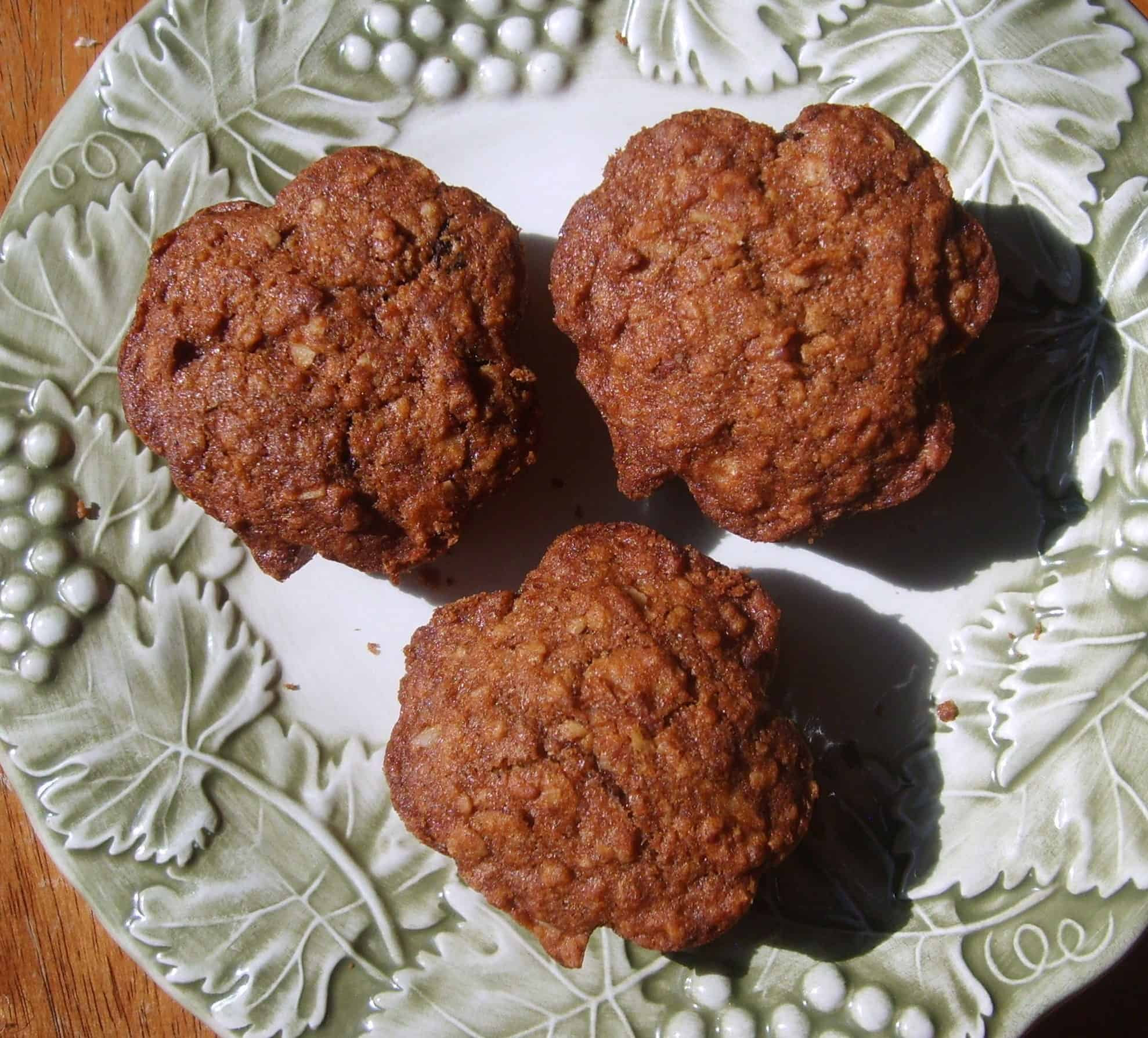 Three muffins in shamrock shape on a plate with green border