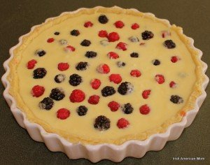 Custard covering berries for a tart before baking