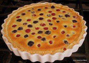 A golden top on a berry custard tart