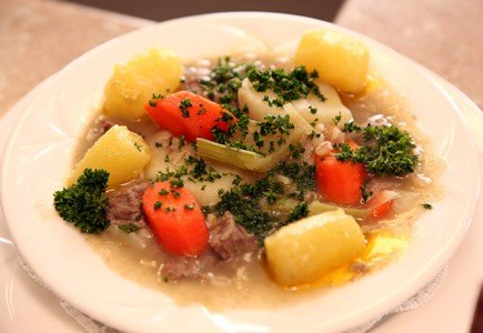 Irish lamb stew with parsley garnish
