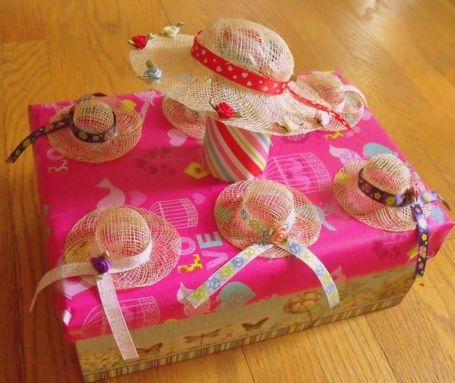 Ribboned hats on a shoe box float
