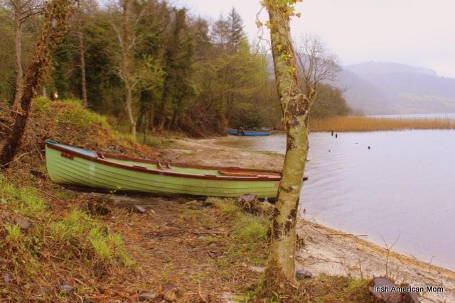 green boat on the lake shore of Glencar Lake in County Sligo
