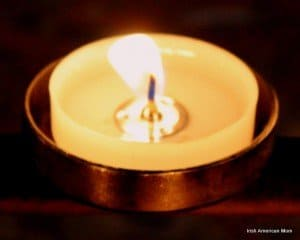 the flame glowing in a votive candle
