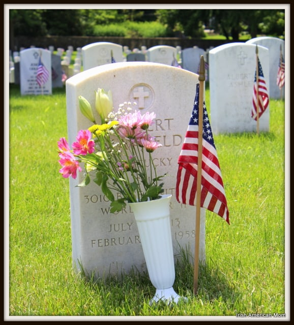 Flowers and American Flag On A Soldier's Grave