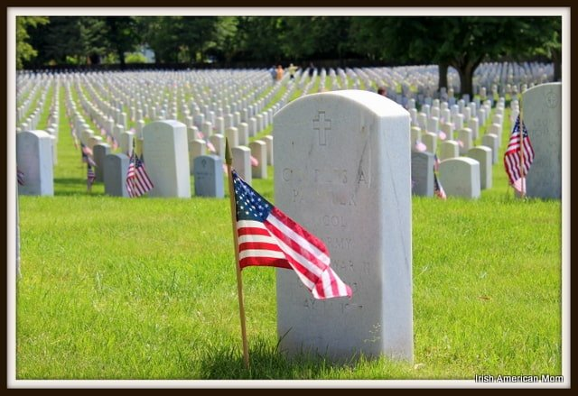 White headstone and American flag in Kentucky