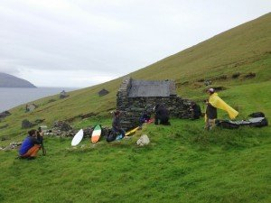 Irish flag surf board beside an abandoned house on the Blasket Islands