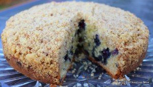 Crumb topped lemon blueberry crumb cake with a slice removed