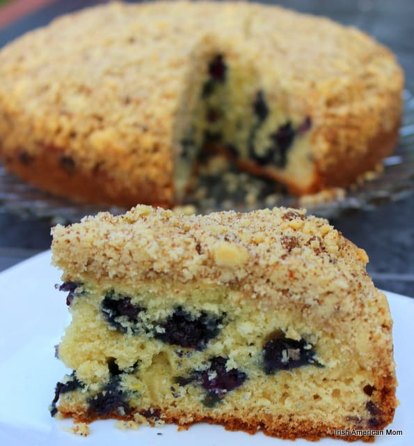 Slice of cake cut out of a lemon blueberry crumb cake