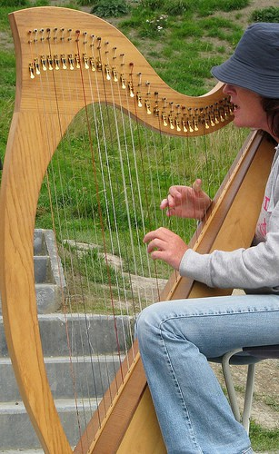 Irish Harp being played by a girl in hat