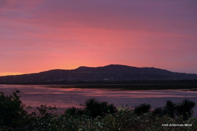 The rising sun casting an orange glow over Howth in County Dublin