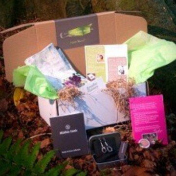 An open giftbox featuring crafts and gifts from My Ireland Box subscription services