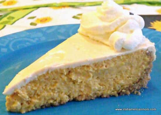 Slice of Baileys pumpkin cheesecake with cream