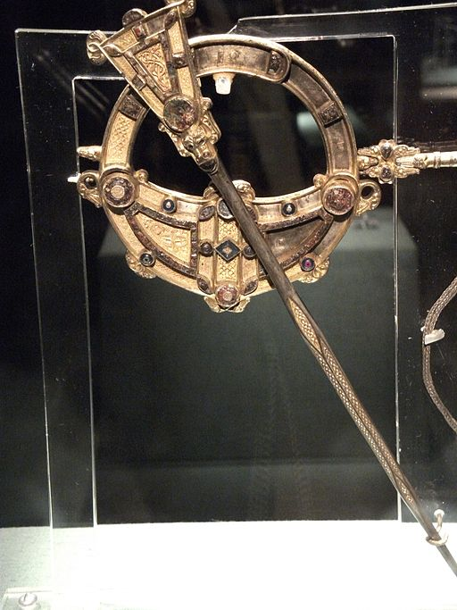 Golden Celtic brooch on display in an Irish museum