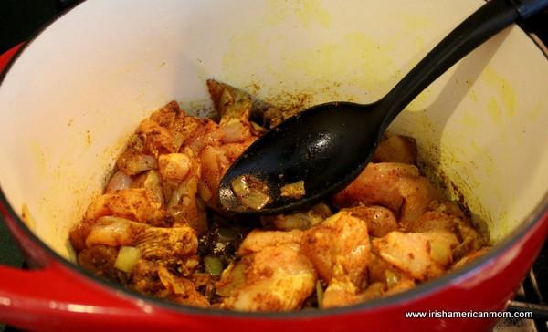 Adding chicken to curry chicken