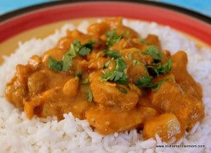 Rice with chicken curry on a plate
