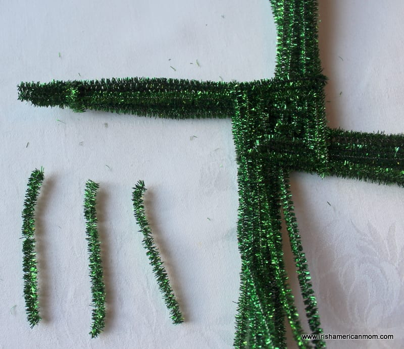 Securing the ends of a St Brigid's Cross with pipe cleaners