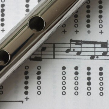 A portion of a tin whistle over a musical score