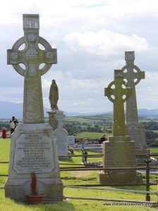 Three Celtic Crosses and statue of Mary on the Rock of Cashel